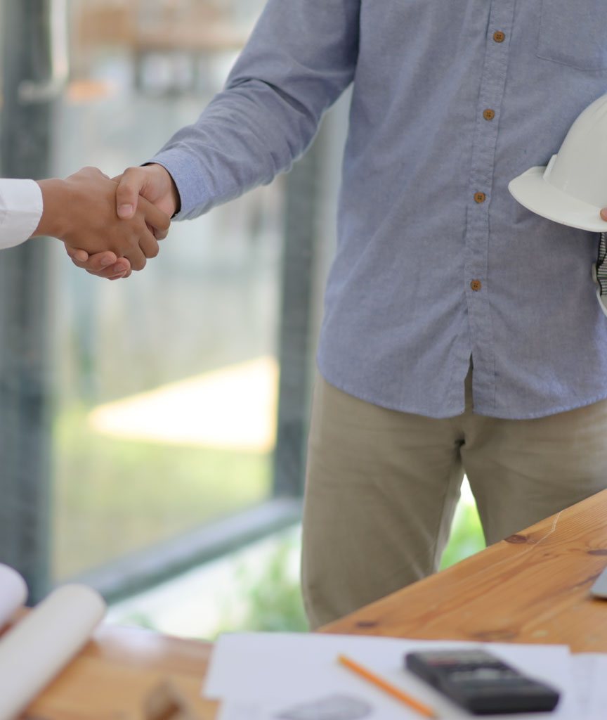Construction Management Company making a handshake